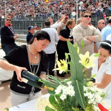 A GLASS OF CHAMPAGNE TO TOAST THE END OF THE GRAND PRIX